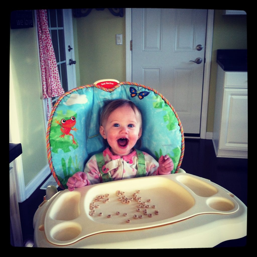 our second child in the highchair in our lime green kitchen at the craigslist house