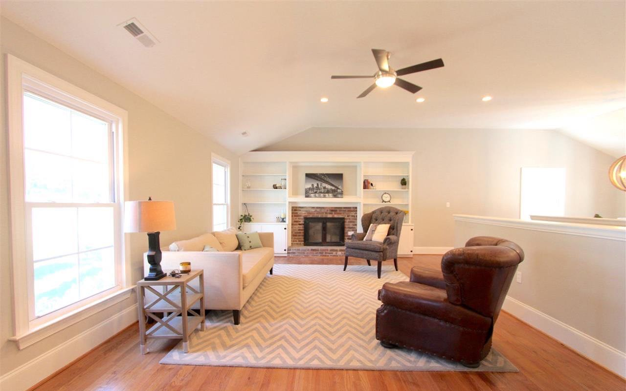 living room renovation with hardwood floors and dark hardware