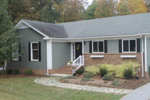 renovated first flip front in Holly Springs with landscaping and new siding