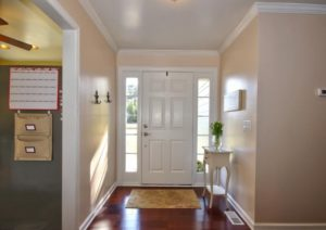 entry way remodeled with hardwood floors and a new door