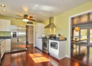 kitchen remodel stainless steel appliances, vent hood, fans, hardwood floors, and paint, full renovation