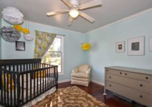 nursery with light blue walls hardwood floors