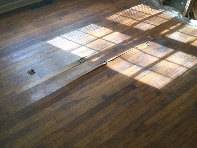 damaged hardwood floors buckled remodel flip raleigh before renovation living room and porch wall ranch \ House Flip by popular US house flip blog, The Inspiring Investment: image of damaged hardwood floors.
