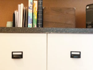 this picture is of file drawers with hardware that doubles as a label - found on amazon