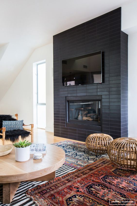 Black Fireplace Ideas featured by top house flipping blog, The Inspiring Investment.