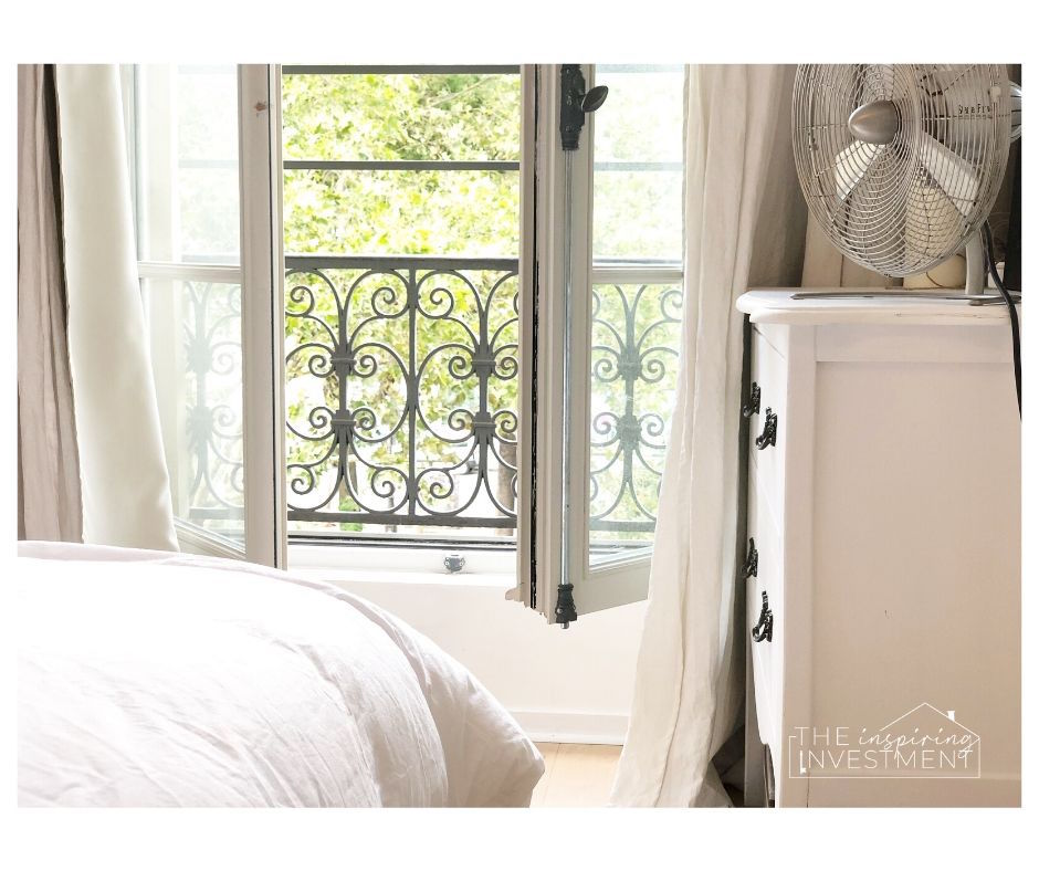 this is a room in an airbnb we stayed at in paris. i love the white linen bedding and curtains, white walls and large windows