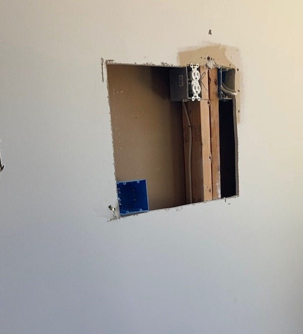 how to move an outlet and do a drywall patch. This picture is after we cut out the hole in the wall