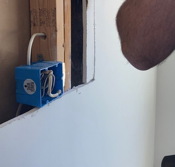 showing you what it looks like to pull wires into an electrical outlet box