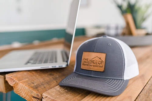 laptop and hat for of The Inspiring Investment on desk