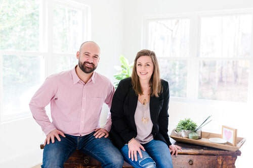 business-owner couple of The Inspiring Investment sitting on desk