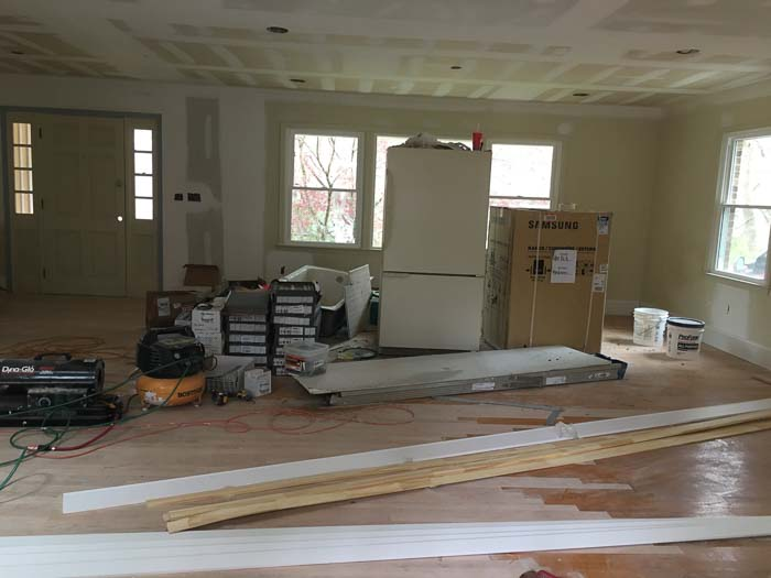 living room after interior wall removal and drywall repairs, before paint.