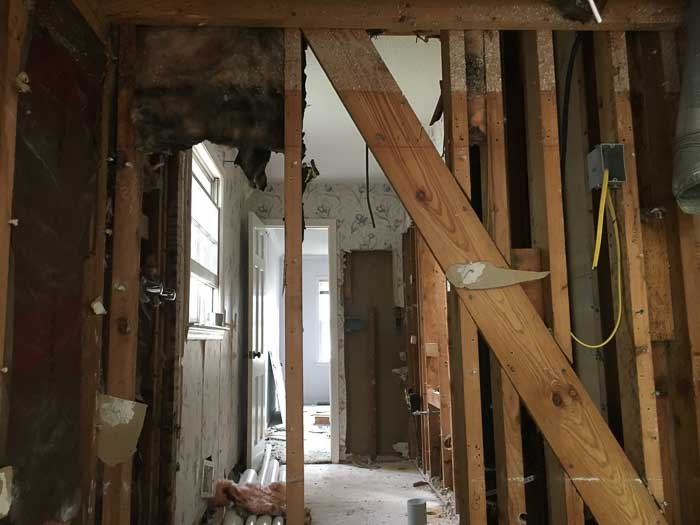 during process of interior wall removal in a home